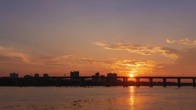 sunset glow cityscape on riverside 4k uhd - ship's bridge stock videos & royalty-free footage