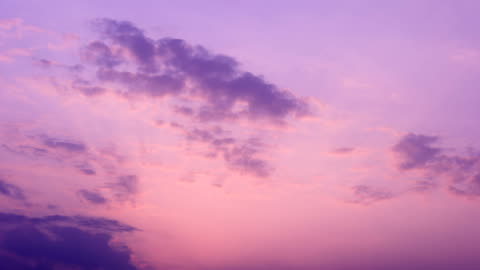 sunset glow moving dusk sky 4k time lapse video - purple stock videos & royalty-free footage