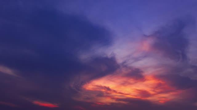 sunset glow through dusk sky 4k uhd - purple stock videos & royalty-free footage