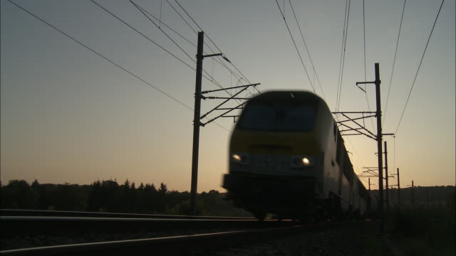 sunset - goods train - railway track stock videos & royalty-free footage