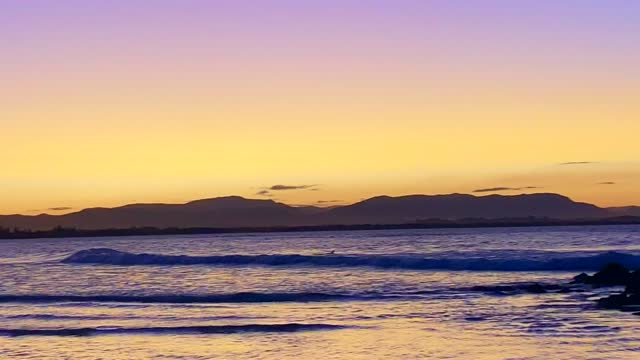 sunset hues at byron bay beach australia - idyllic stock videos & royalty-free footage