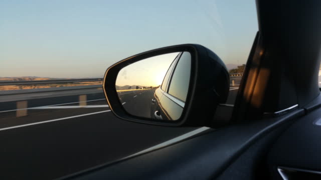 sunset in a rear view mirror - rear view mirror stock videos & royalty-free footage