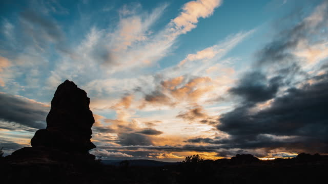 sunset in arches national park utah time lapse - cloud sky stock videos & royalty-free footage