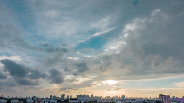sunset in bangkok city : day tonight time-lapse gray clouds sky with cityscape. - gru video stock e b–roll