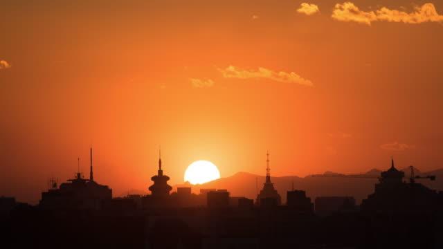 sunset in beijing - turmspitze stock-videos und b-roll-filmmaterial
