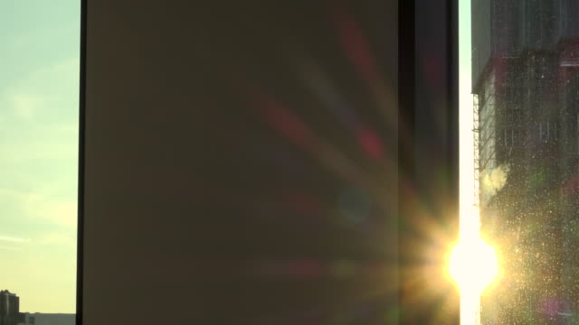 sunset in city hand truck shot - solar flare stock videos and b-roll footage