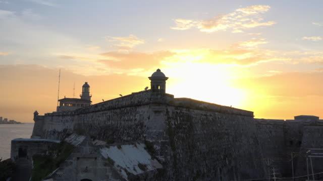 sunset in el morro fort, old havana, cuba - history stock videos & royalty-free footage