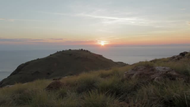 Sunset in Komodo archipelago with Mountain and  the sea in the background