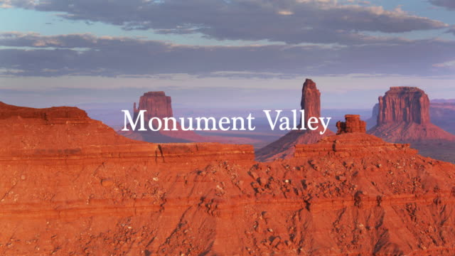 sunset in monument valley - drone shot with floating text - navajo reservation stock videos and b-roll footage