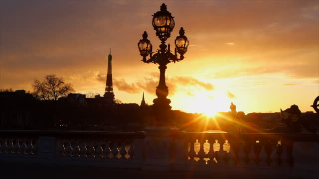 sunset in paris with the eiffel tower - monument stock videos & royalty-free footage