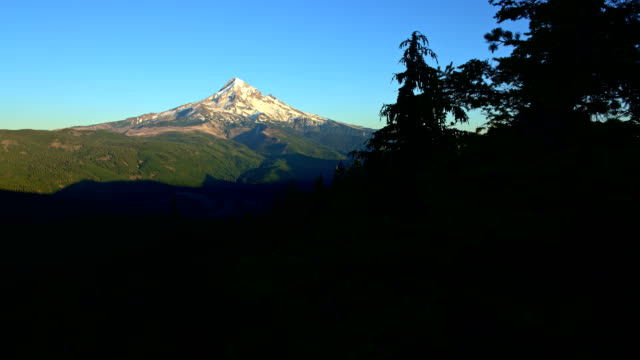 Sunset in summer pan on snowy mountain and forest valley Mt. Hood from Lost Lake Butte