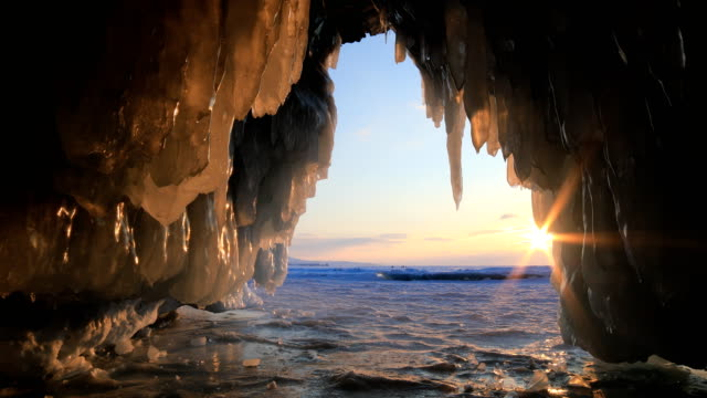 sunset in the ice cave on lake baikal - cave stock videos & royalty-free footage