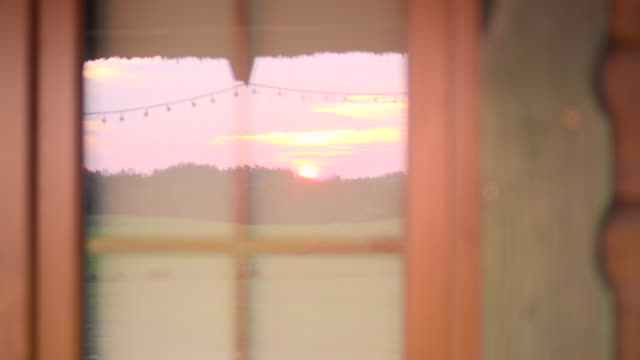 sunset in the window reflection - window frame stock videos and b-roll footage