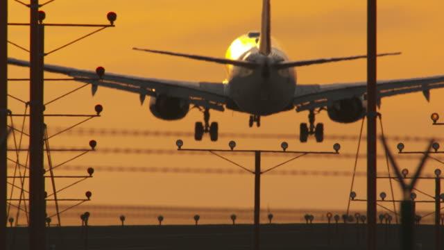 sunset landing at lax - landing touching down stock videos & royalty-free footage
