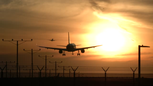 sunset landing at lax - landing touching down stock videos & royalty-free footage