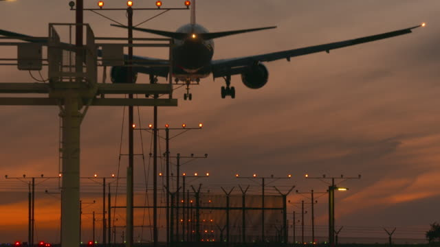 sunset landing - boeing 787 stock videos and b-roll footage