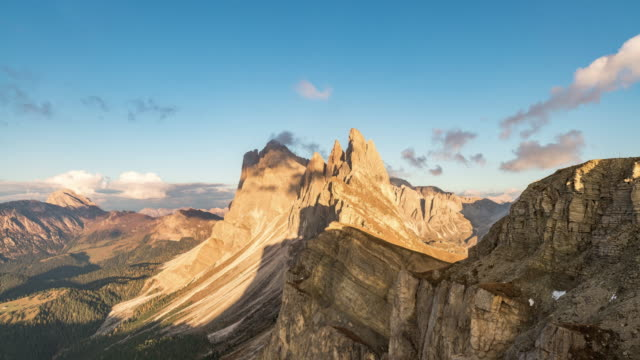 sunset landscapes in seceda with clouds and blue sky in dolomites, south tyrol, italy - süden stock-videos und b-roll-filmmaterial