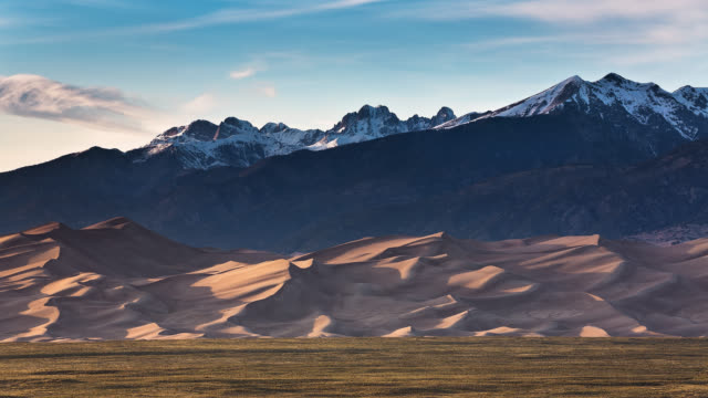 t/l sunset light dancing on great sand dunes national park with view of sangre de cristo mountains / great sand dunes national park and preserve, colorado, usa - colorado stock videos & royalty-free footage