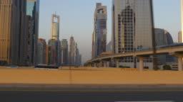 sunset light dubai city downtown driving car pov side panorama 4k united arab emirates