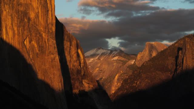 sunset light on el capitan - yosemite national park stock videos and b-roll footage