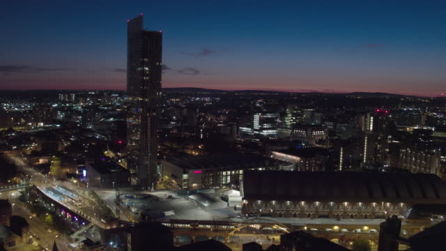 sunset manchester city centre, drone aerial view with city lights - manchester england stock videos & royalty-free footage