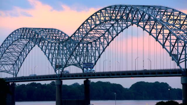 sunset new bridge multi lane highway mississippi river - river mississippi stock videos & royalty-free footage