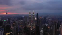 sunset night illumination kuala lumpur downtown aerial panorama timelapse 4k malaysia