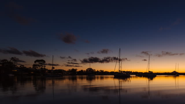 4K Sunset - night time lapse at Noosa with boats, Queensland, Australia