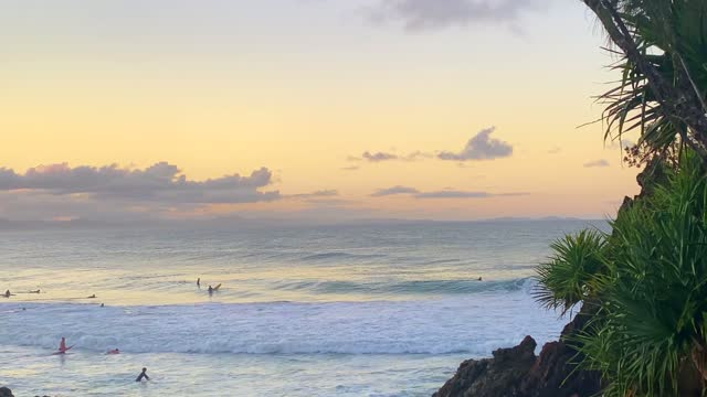 sunset ocean surfing views from rocks - active lifestyle stock videos & royalty-free footage