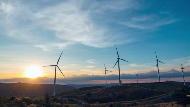 t/l, sunset of a wind turbine. - generator stock videos and b-roll footage