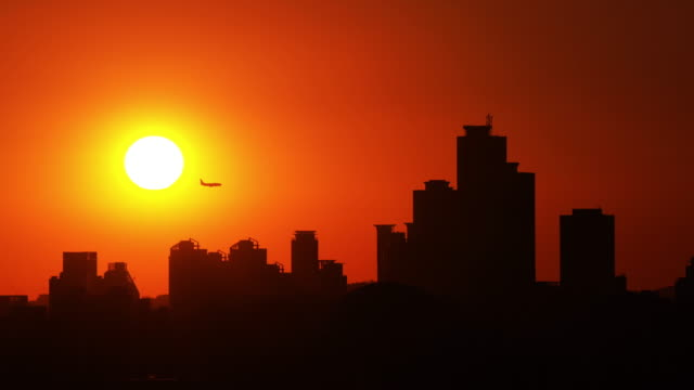 sunset of airplane flight over the city buildings in mok-dong, seoul - mok stock videos and b-roll footage