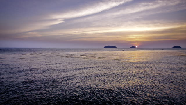 sunset of sun setting over ocean - pacific islands stock videos & royalty-free footage
