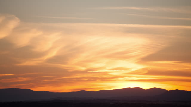 (4k) Sunset of the National Park of Guadarrama mountains. View from Madrid, Spain.