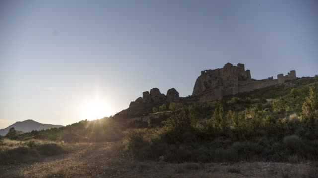 sunset of the ruin of the castle in a hillside - dessert stock videos & royalty-free footage
