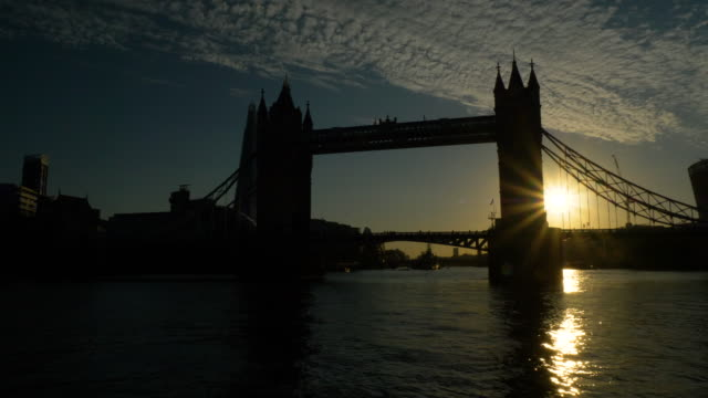 sunset of tower bridge in london - tower bridge stock videos & royalty-free footage
