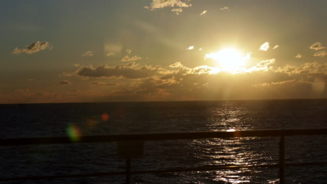 sunset off of a ship near mauritius - ponte di una nave video stock e b–roll