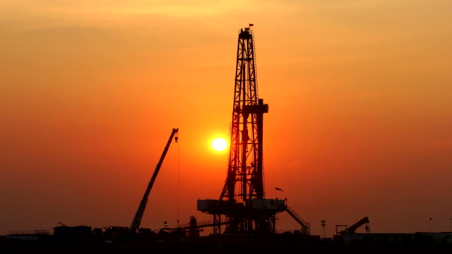 Sunset oil rig time lapse
