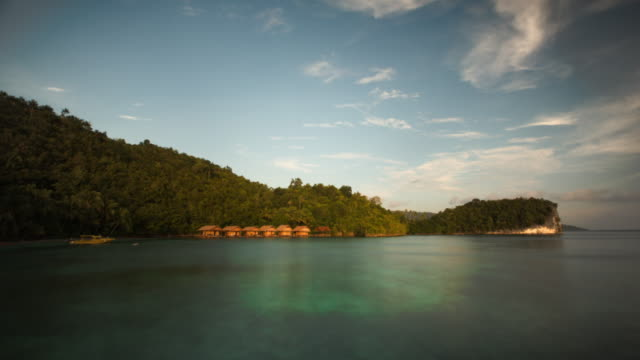 sunset on a beautiful exotic tropical island in raja ampat. - papua stock videos and b-roll footage