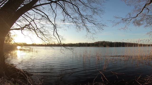 sunset on a lake - relaxation stock videos & royalty-free footage