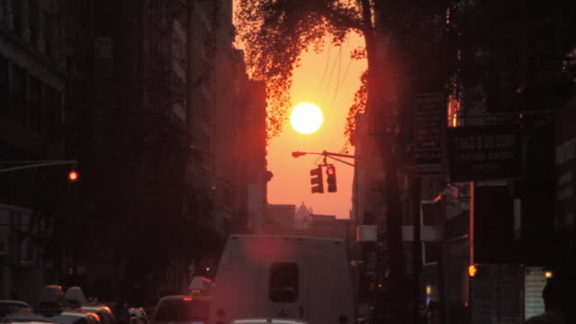 sunset on a new york street - road signal stock videos & royalty-free footage