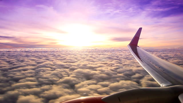 sunset on air plane window view - aircraft wing stock videos & royalty-free footage