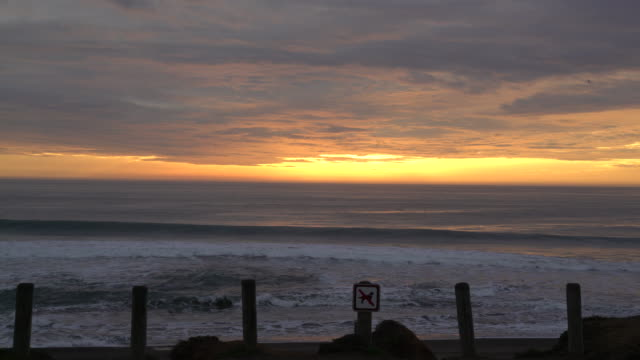 sunset on beach - no parking sign stock videos & royalty-free footage