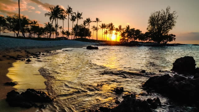 sunset on kukio beach sunset surf - twilight stock videos & royalty-free footage