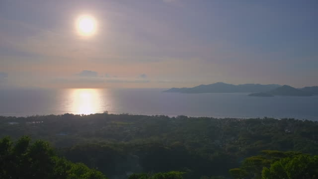 sunset on la digue island , view from highest vantage point of the island restaurant belle vue , seychelles , archipelago country in the indian ocean - seascape stock videos & royalty-free footage