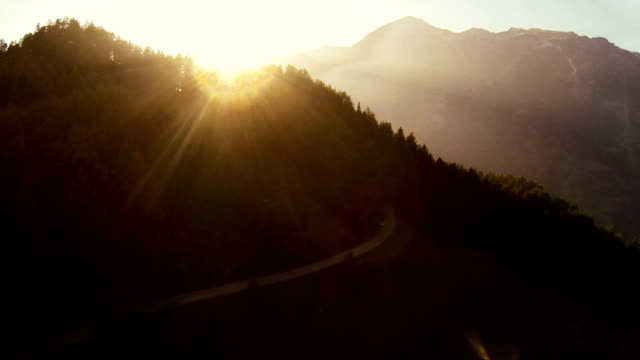 sunset on mountain - aerial view - mountain peak stock videos and b-roll footage