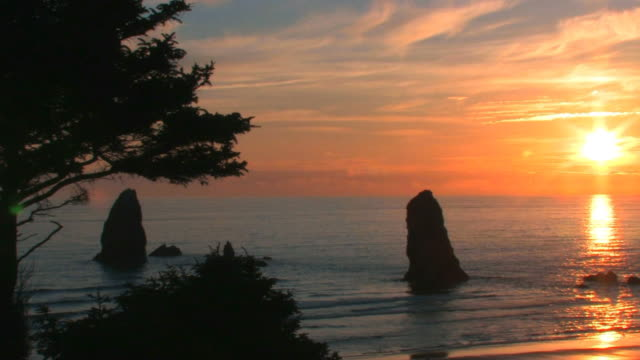 sunset on oregon coast - cannon beach stock videos & royalty-free footage