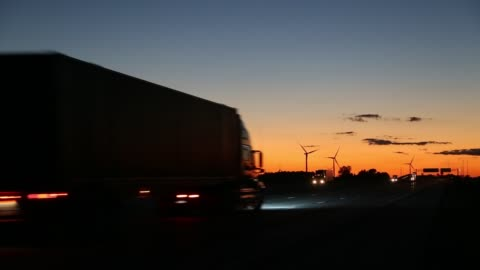 sunset on road with wind turbines - 1 minute or greater stock videos & royalty-free footage