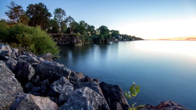 sunset on rocks on lake erie shore - pennsylvania stock videos and b-roll footage