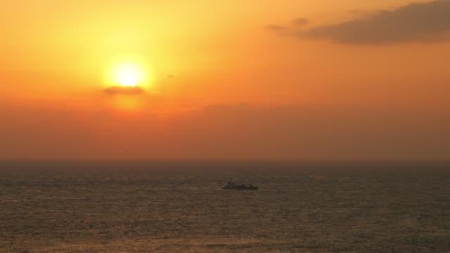 sunset on the hoyo strait - stretto video stock e b–roll