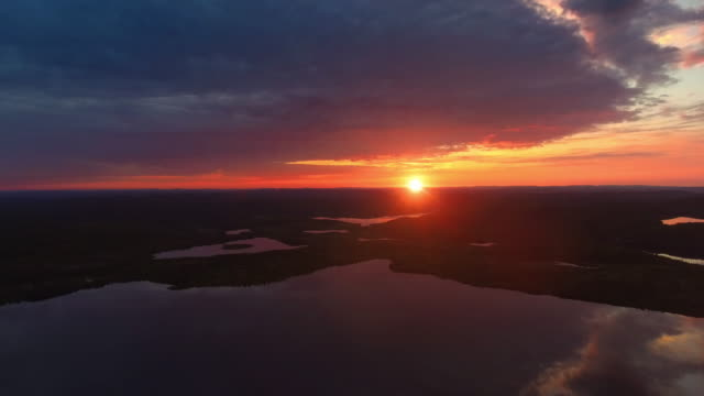 sunset on the lake - finlandia video stock e b–roll